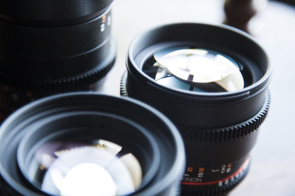 two black telephoto lens on tabletop
