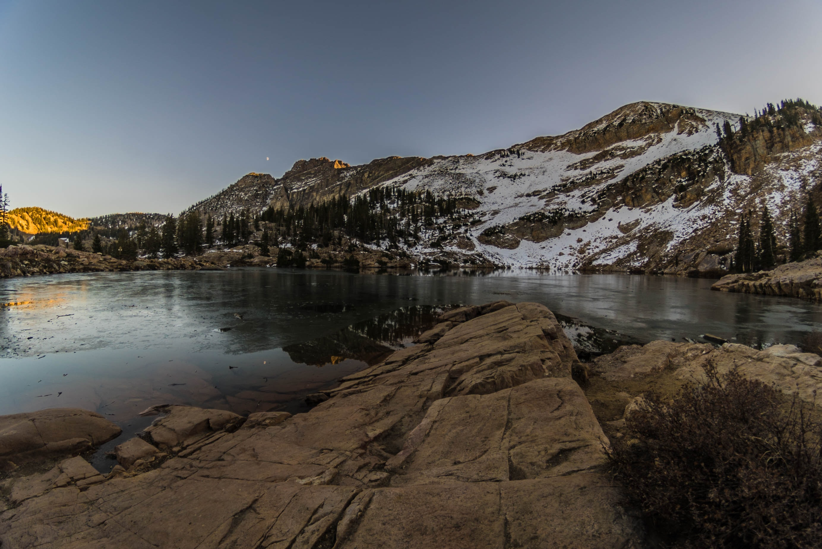 rockformation near lake under white sky