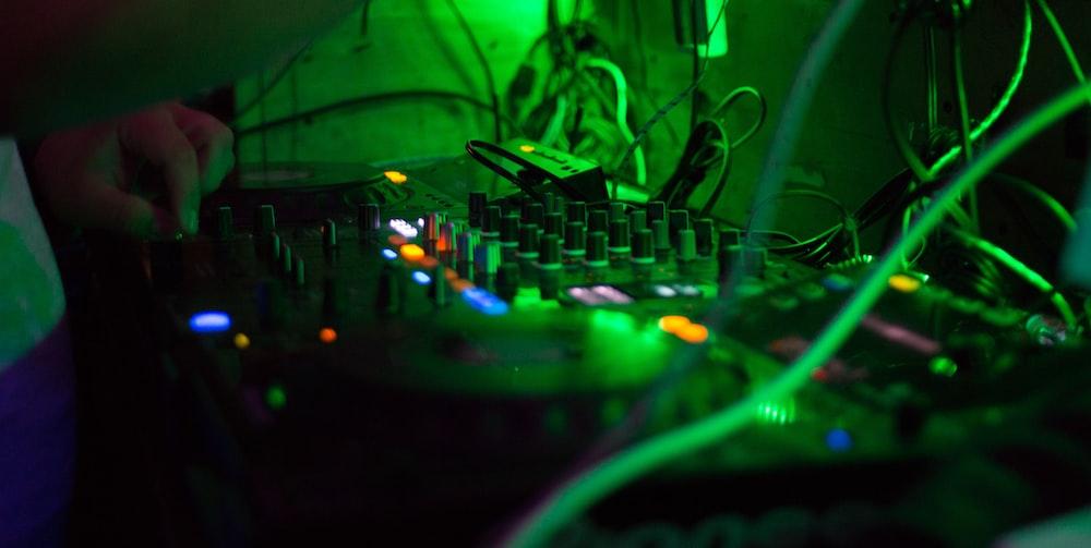 person holding audio mixer