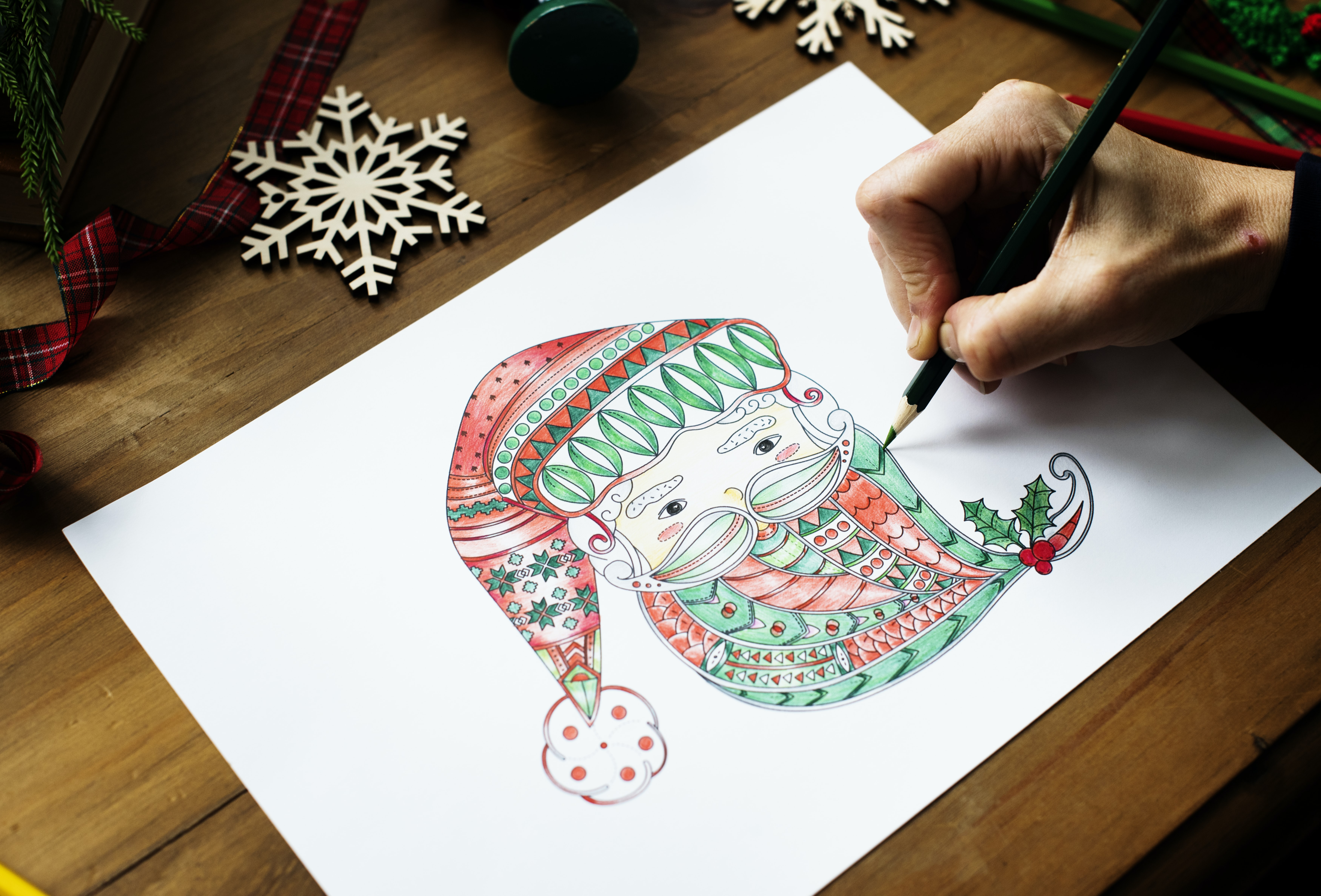 person draws Santa Claus face