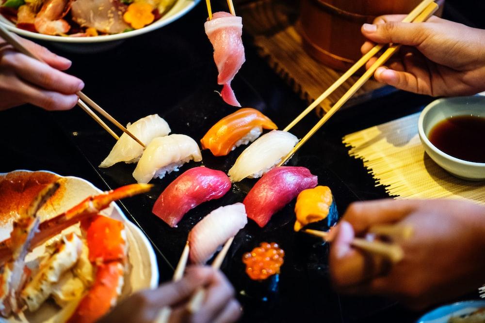 people eating sushi