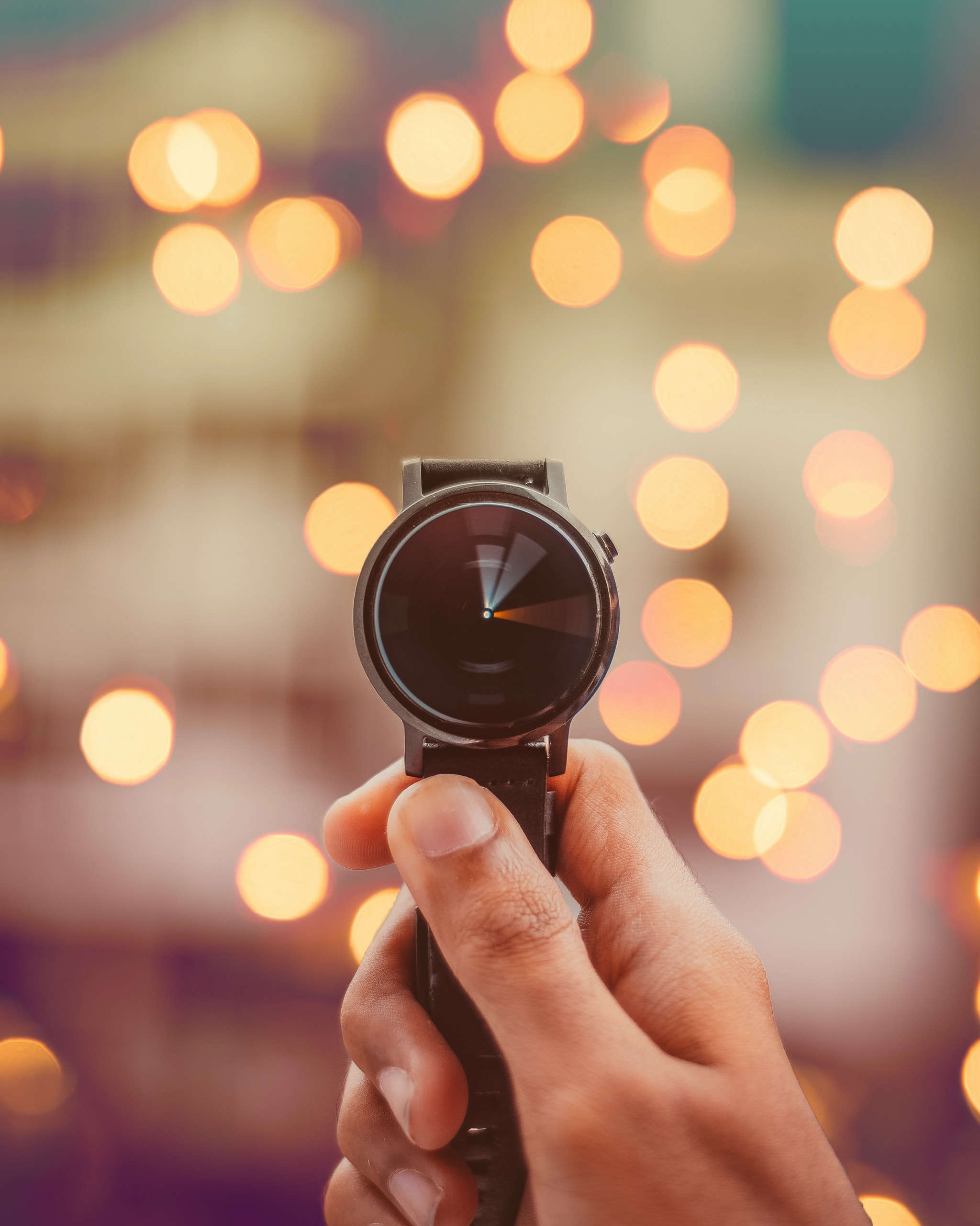 round silver-colored smartwatch bokeh photography