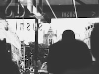 grayscale photography of man inside bus