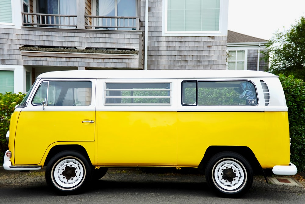 yellow and white Volkswagen Kombi