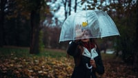 selective focus photography of woman holding umbrella