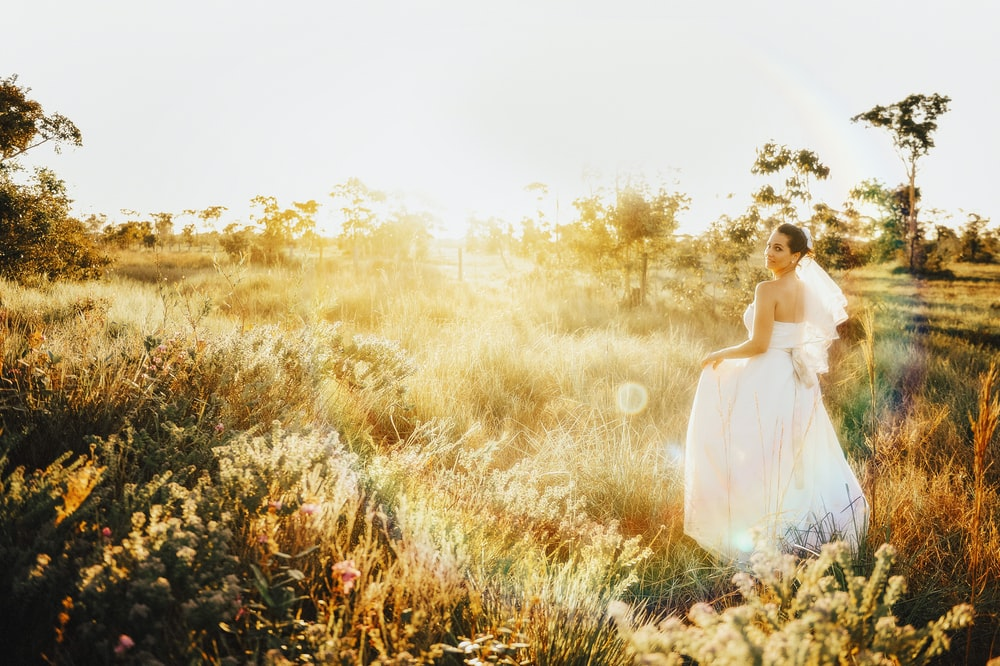woman in white gown on grassland