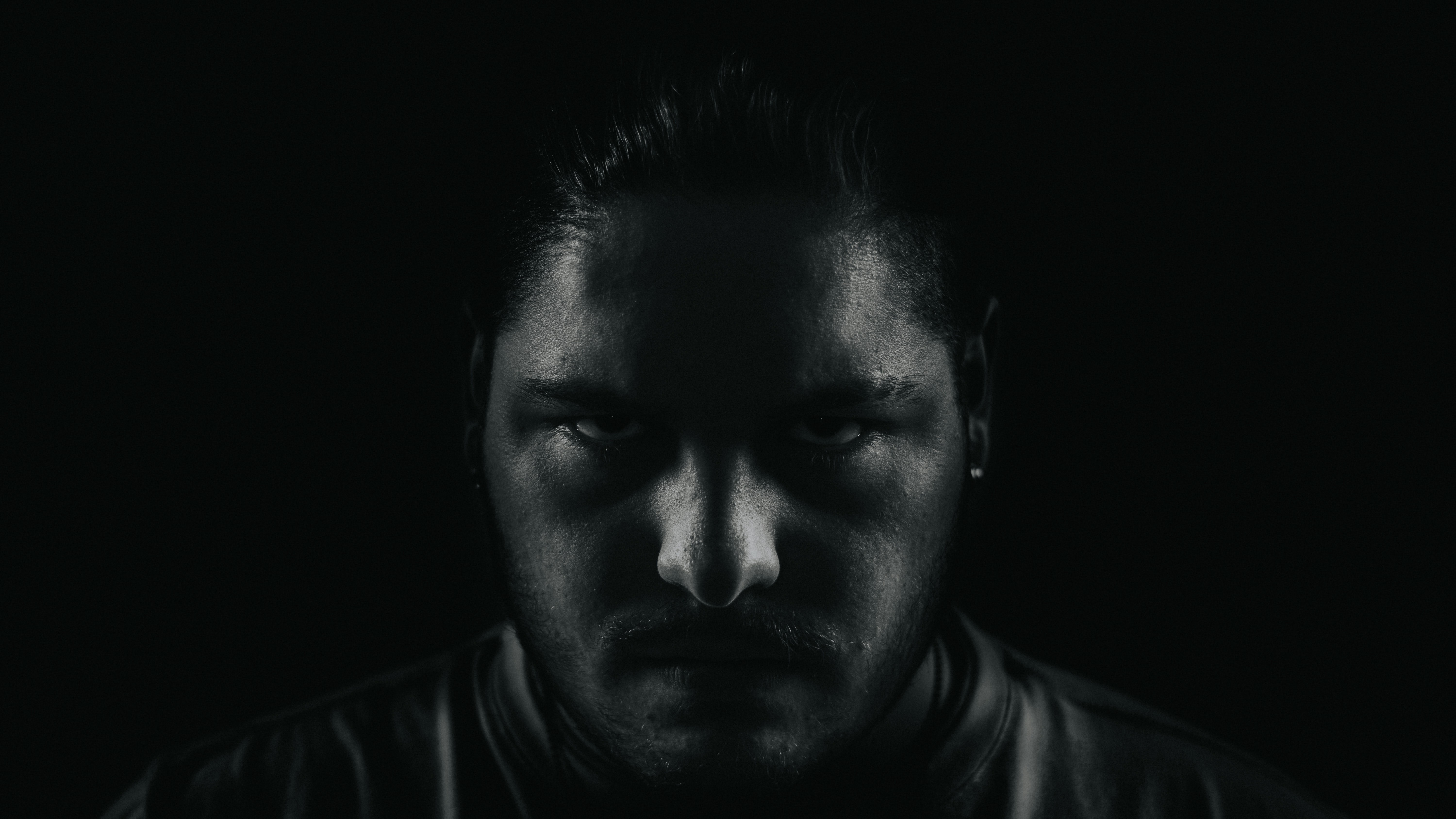 grayscale portrait photo of man