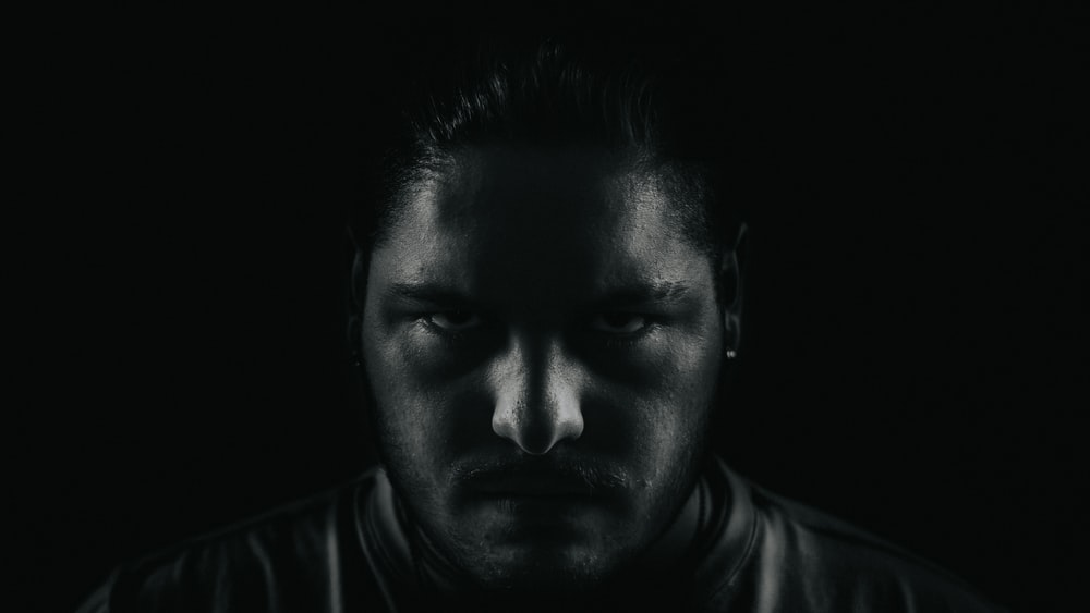 grayscale portrait photo of man