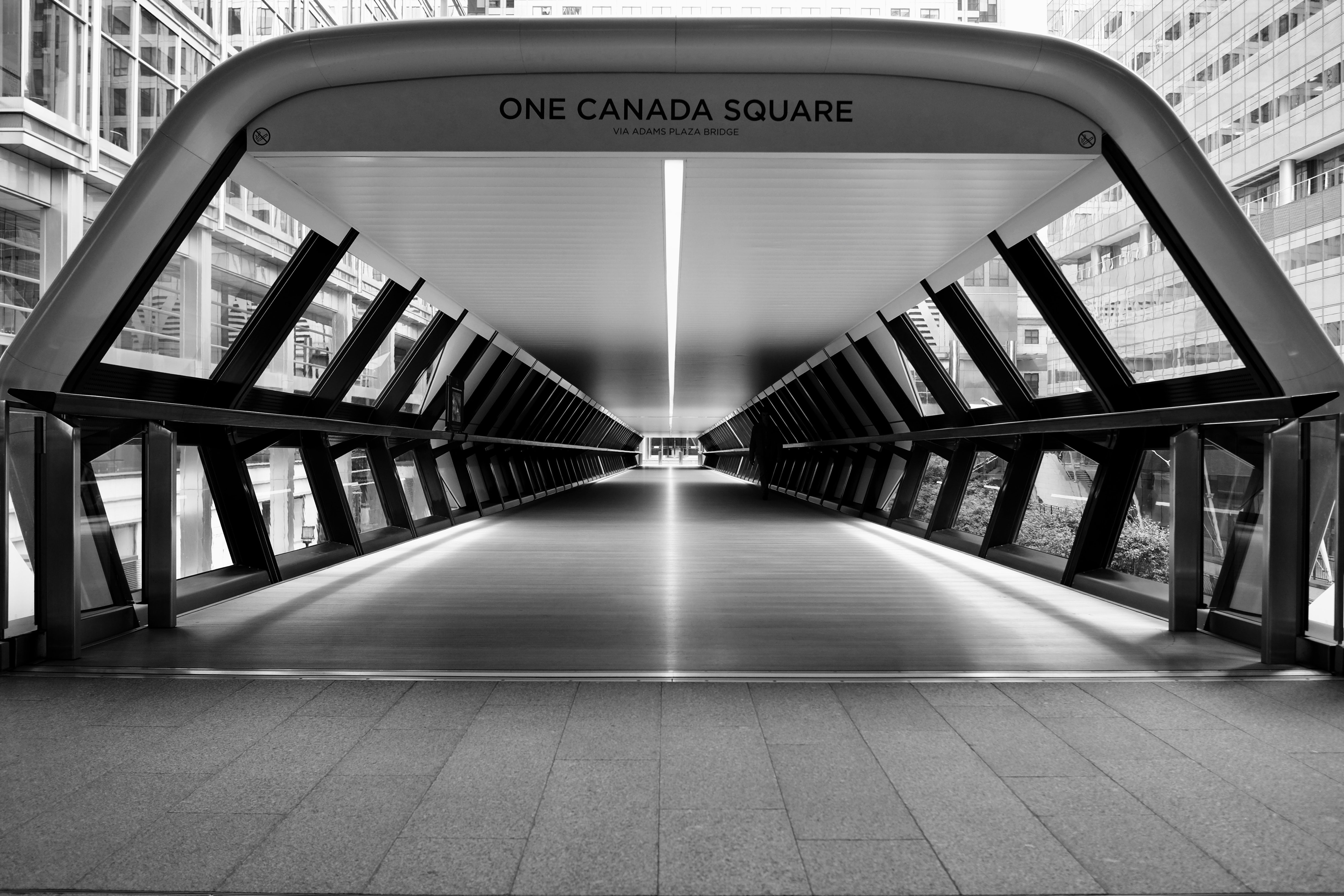 gray scale photo of One Canada Square pathway