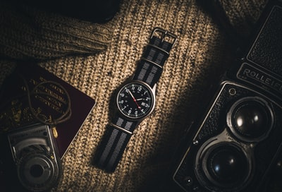 analog watch on brown textile watch zoom background