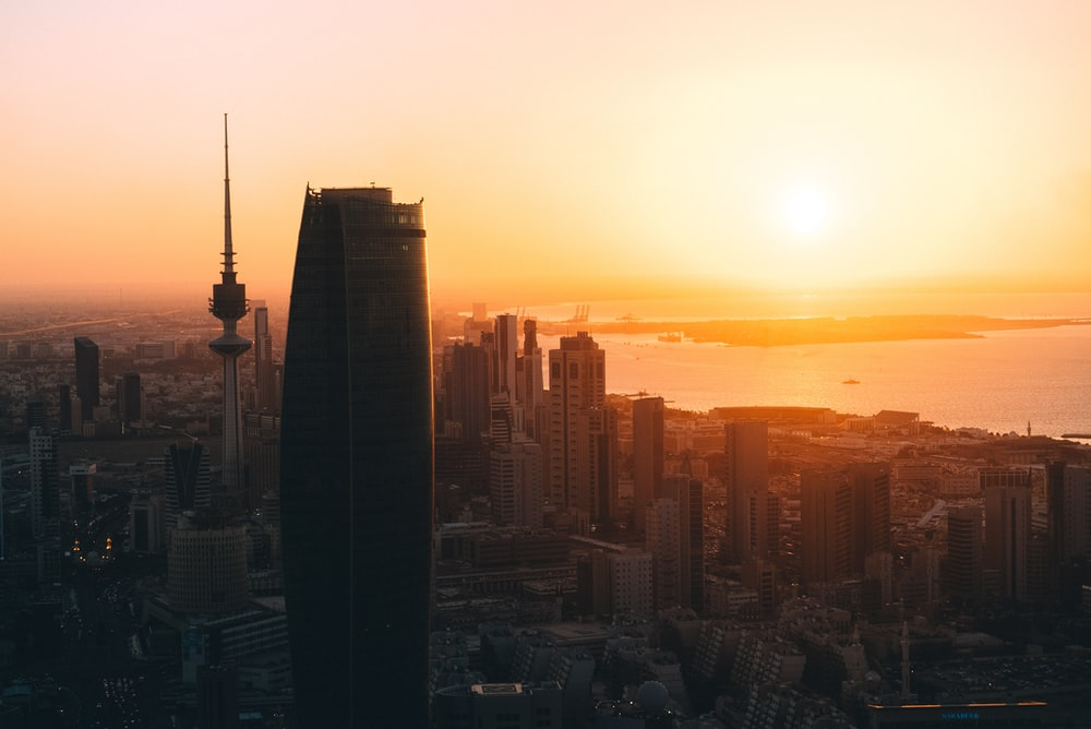 high rise buildings during sunrise