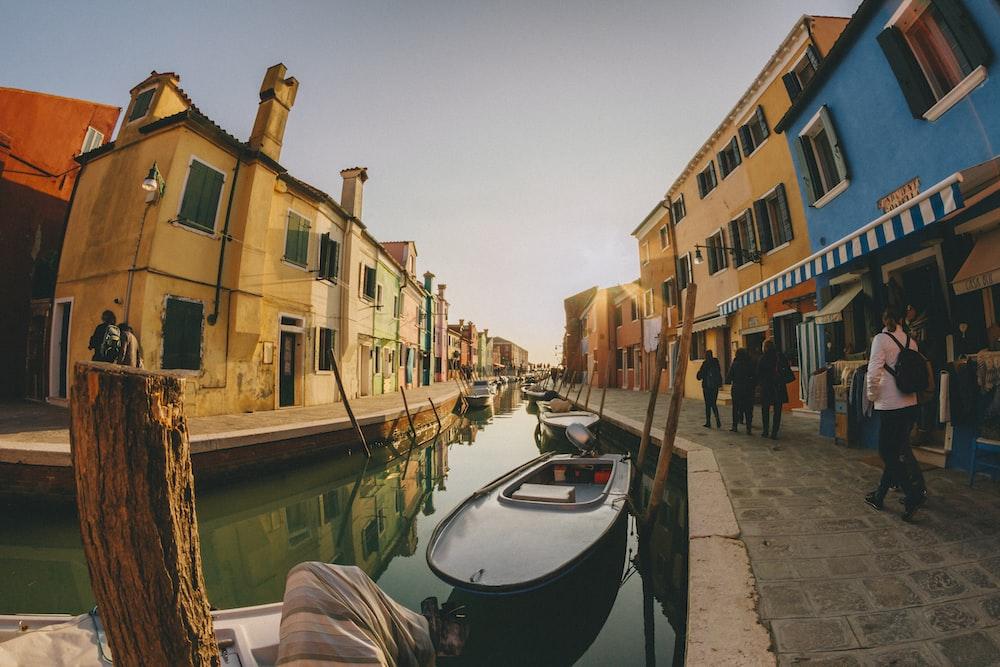 people walking near canal