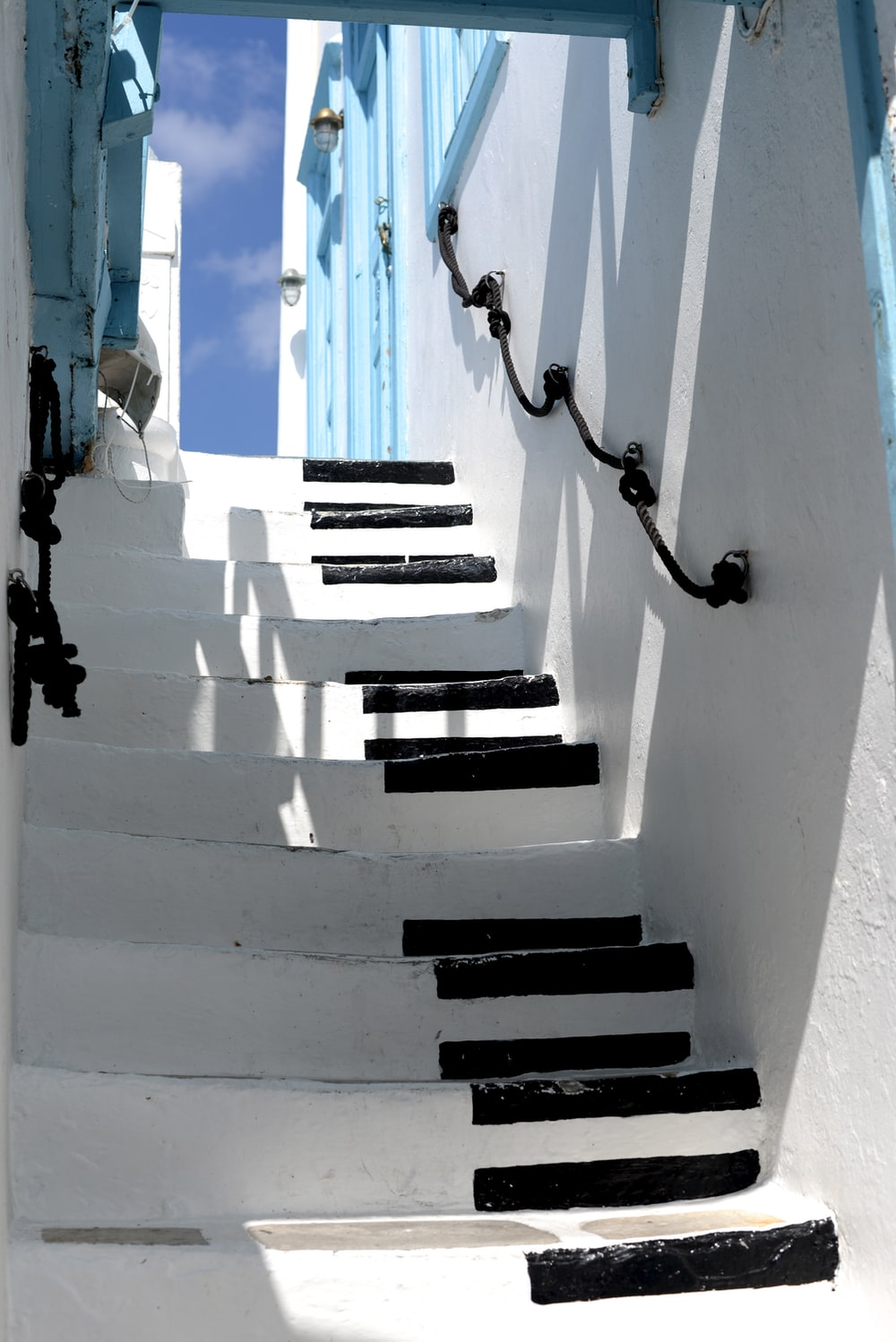 white and black piano keys-themed stairs during daytime