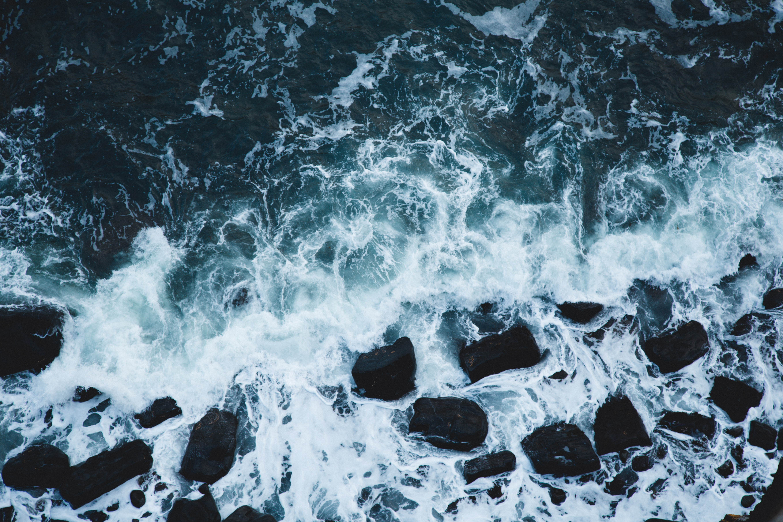 sea waves splashing on rock shore