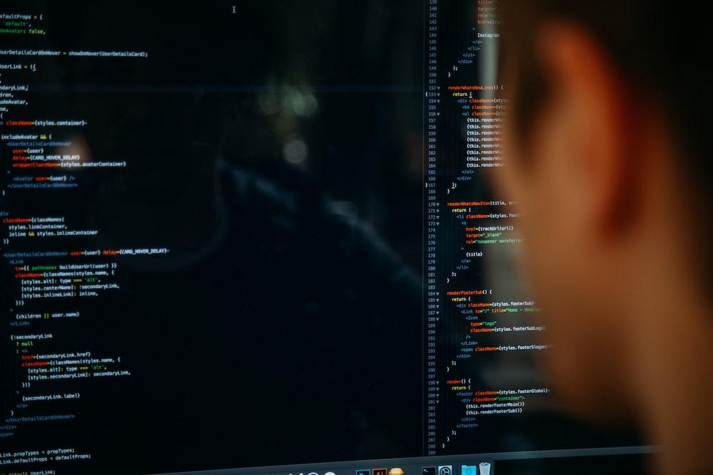 person facing computer desktop