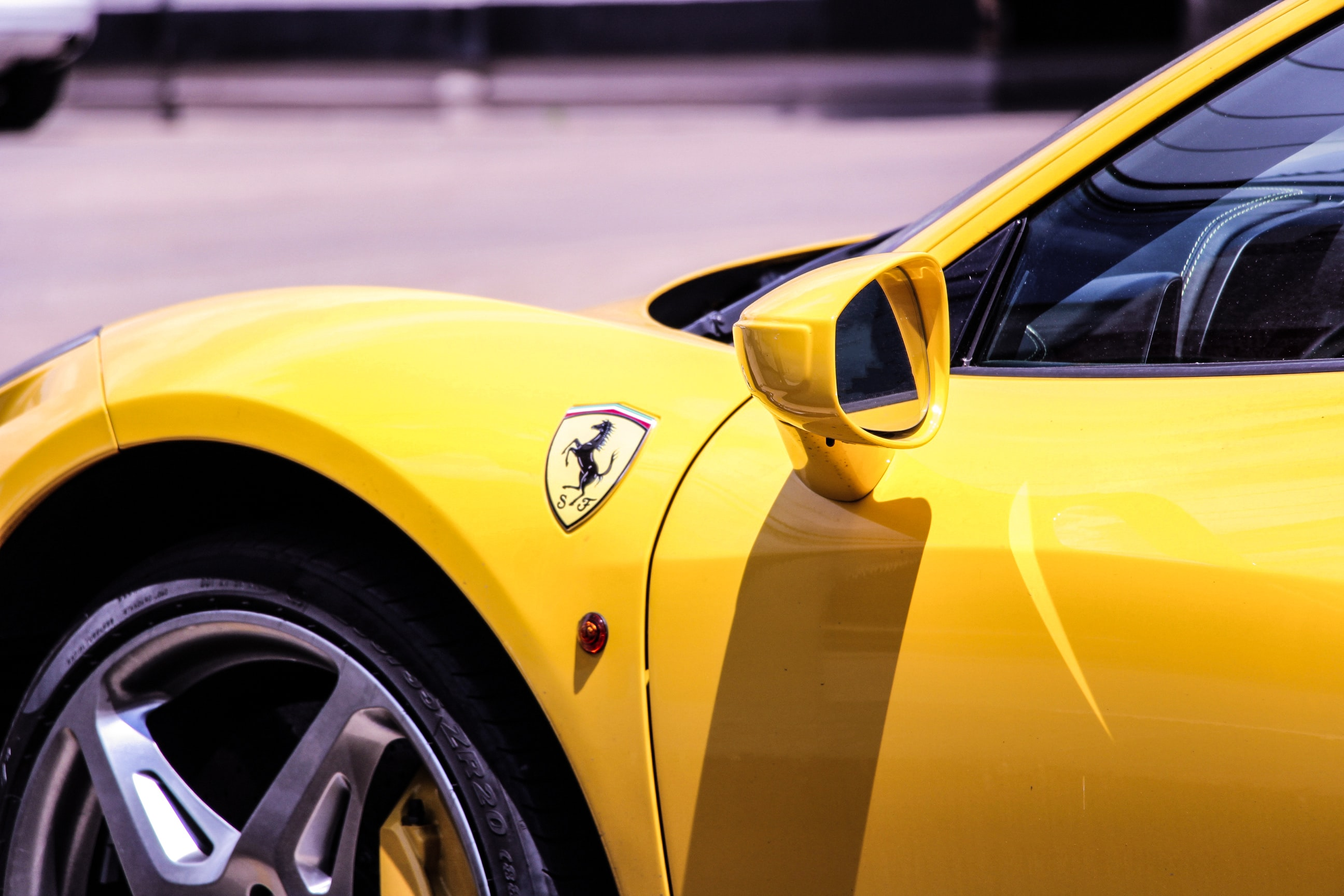 yellow Ferrari car