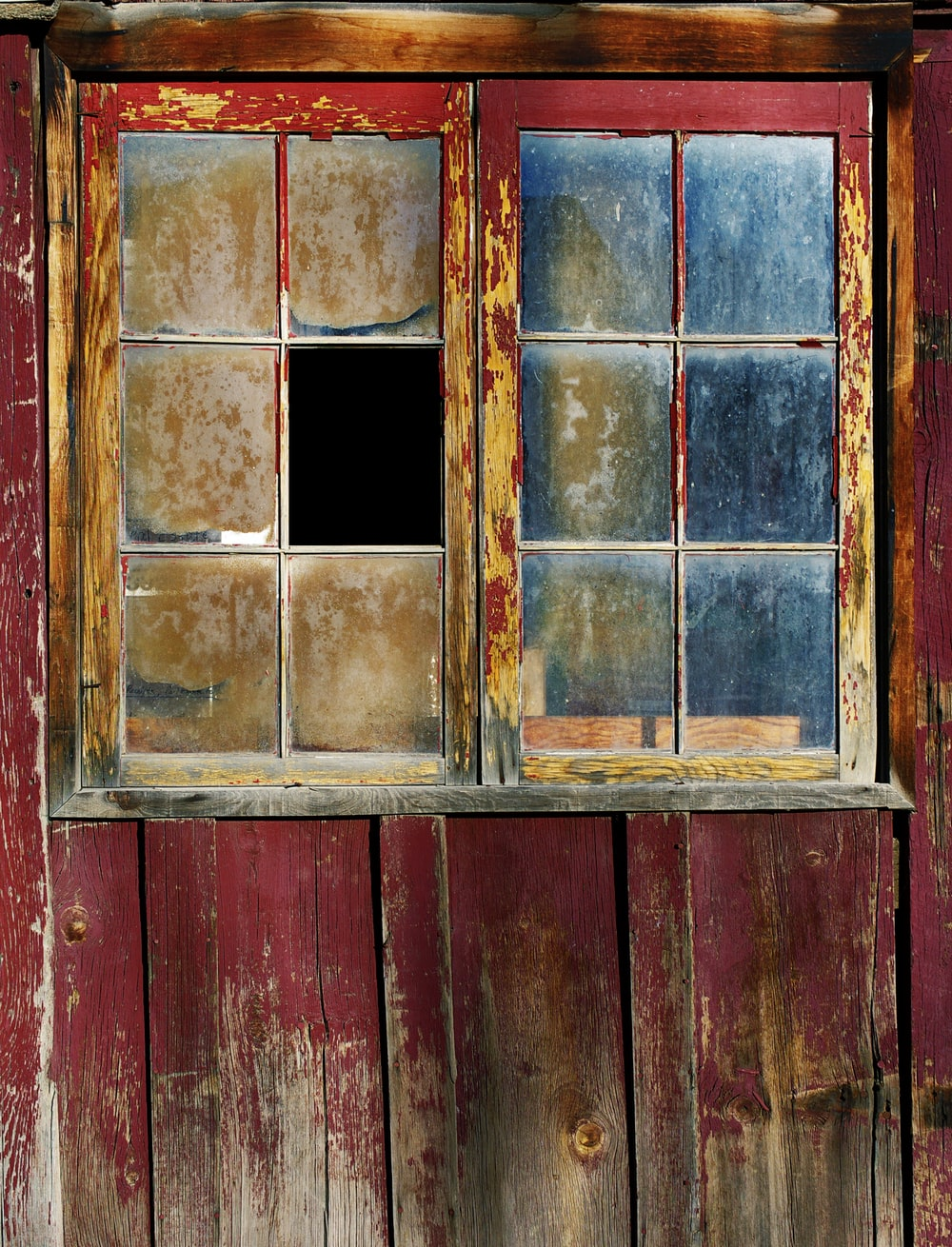 red wooden framed glass broken window