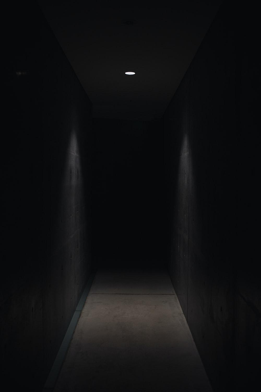 dark pathway lit with small light fixture