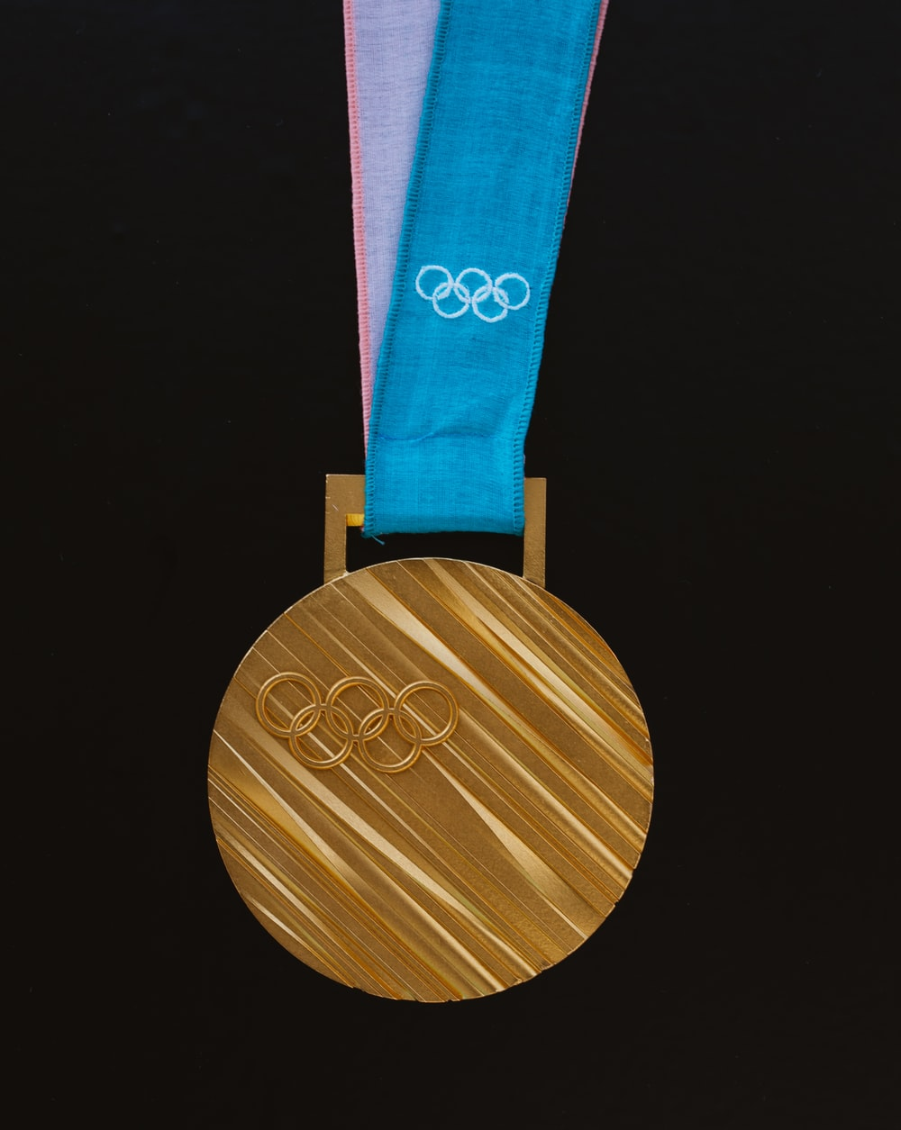 gold-colored Olympics medallion