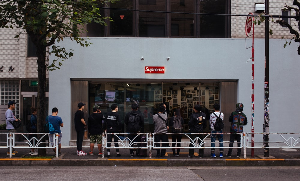 people in line in front of Supreme store