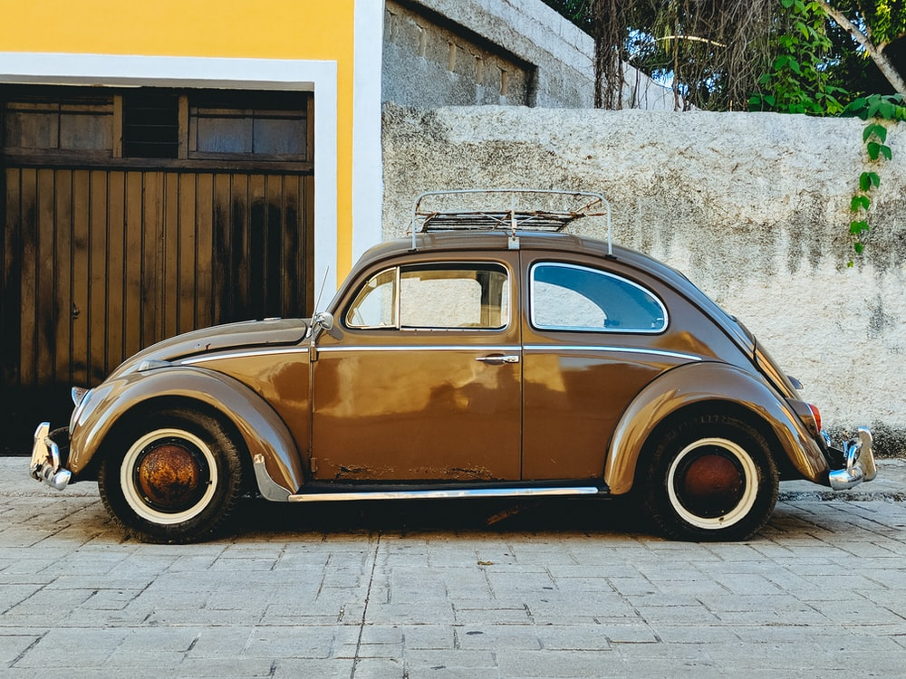parked brown Volkswagen beetle