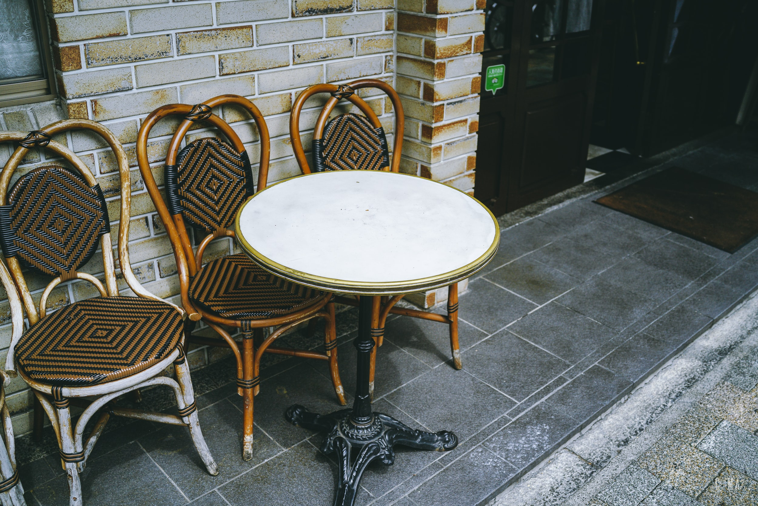 round white wooden table with three chairs