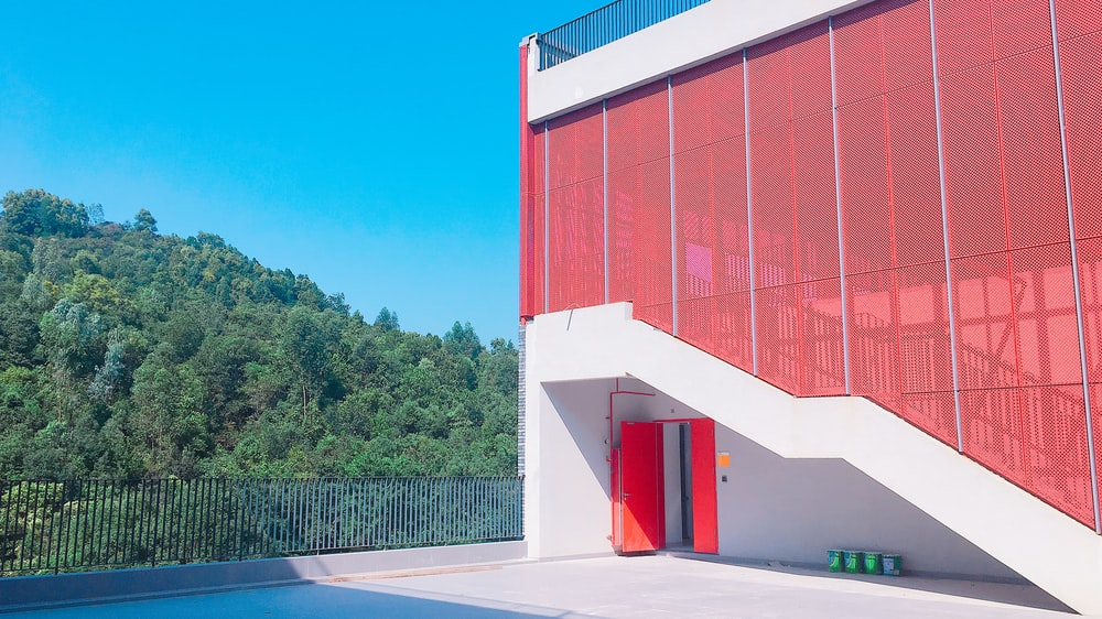red and white tinted glass building