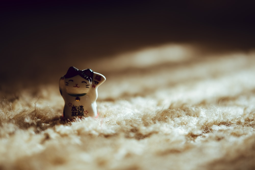 white and black ceramic cat figurine