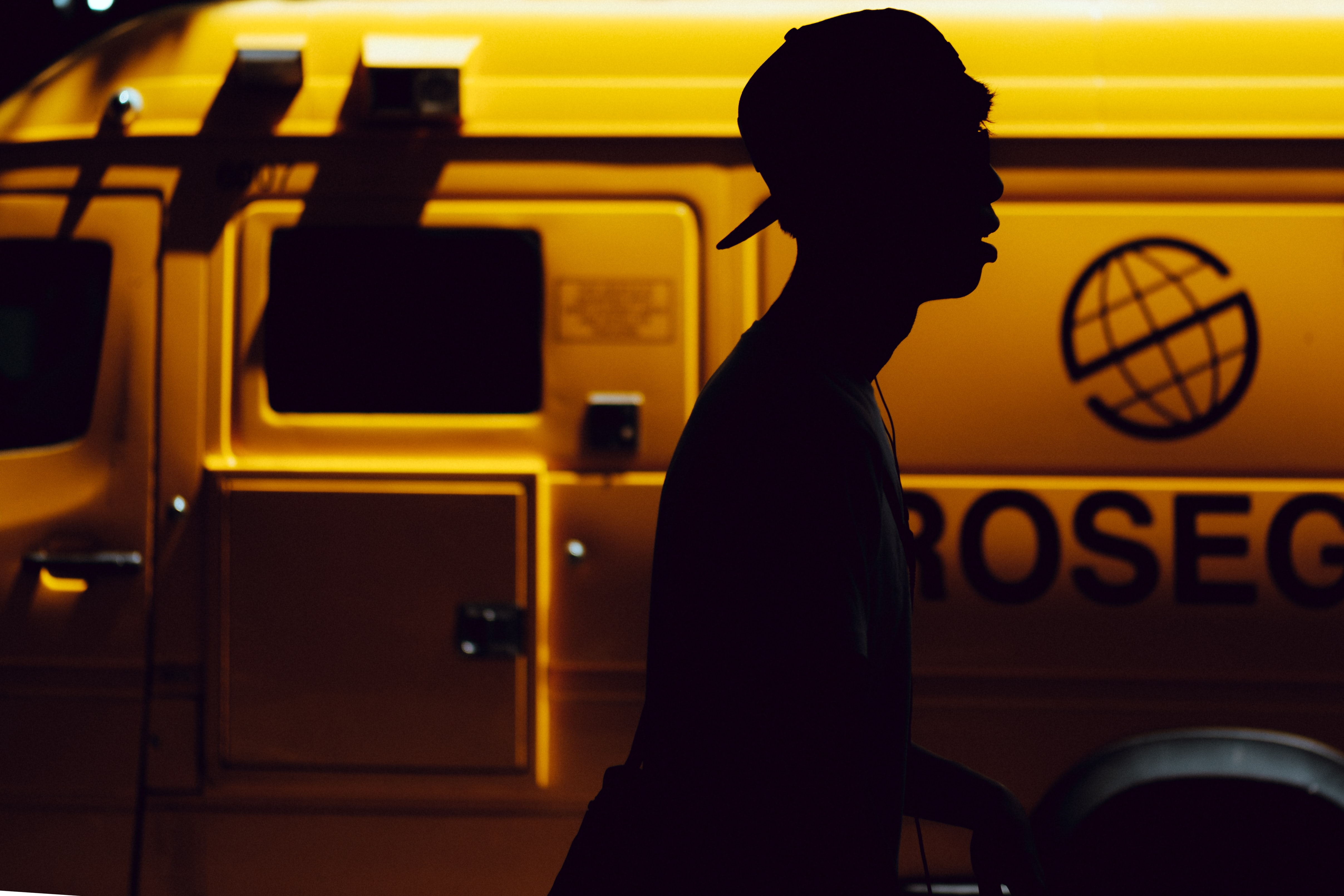 silhouette of boy standing near vehicle