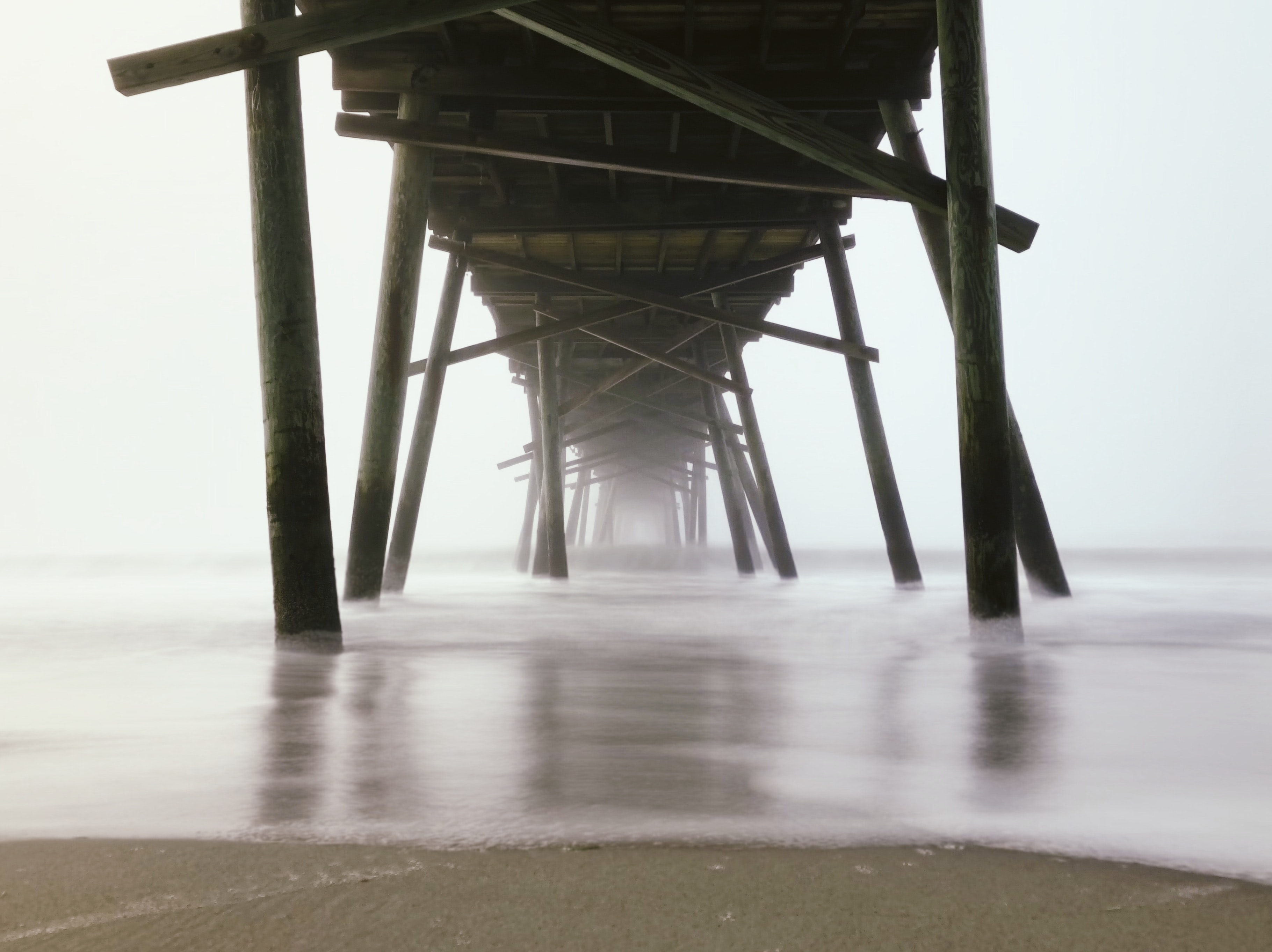worm's-eye view photography of brown wooden dock
