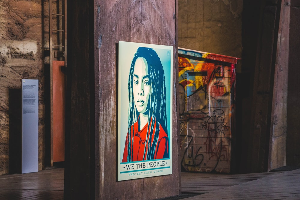 person's portrait poster on wall