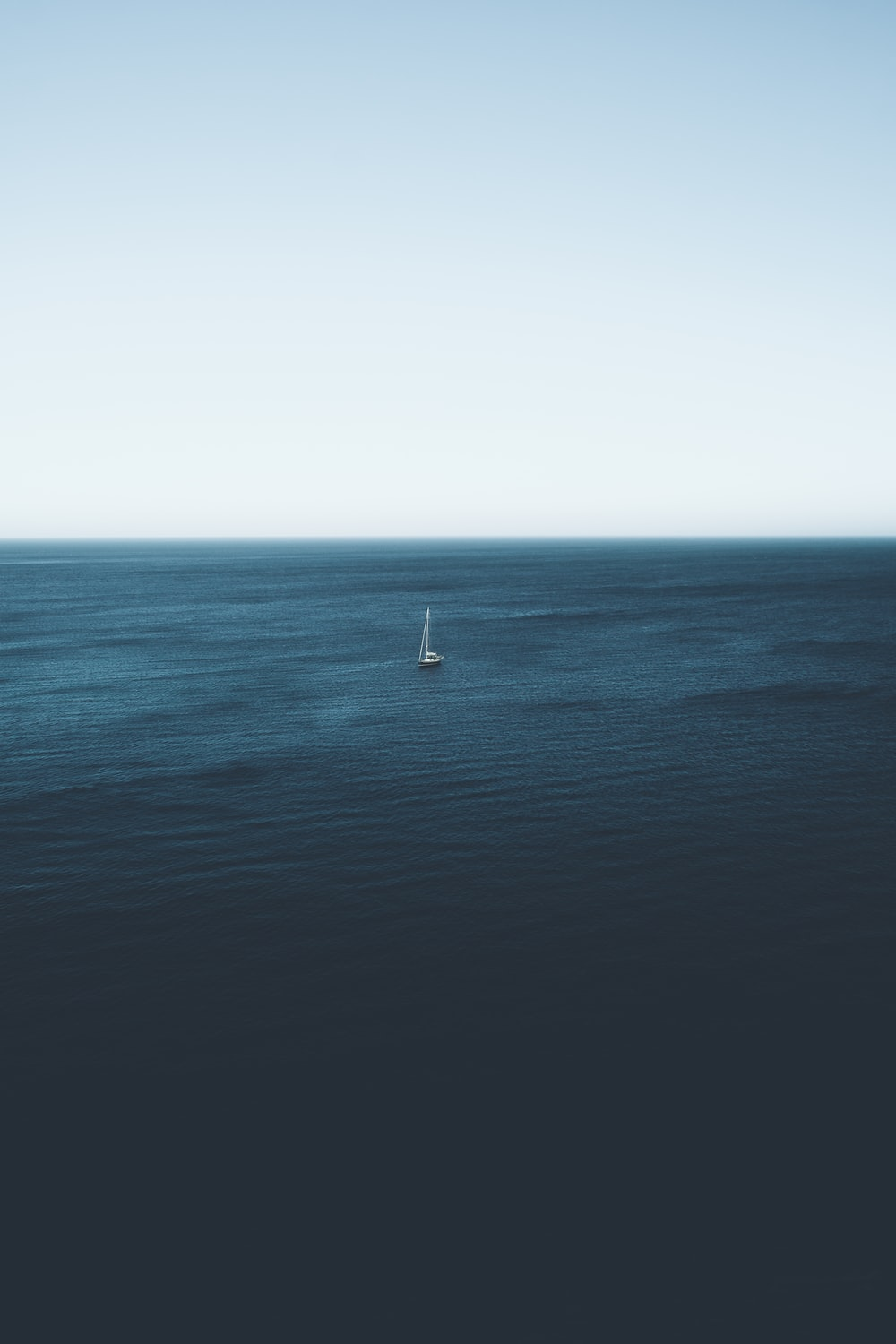 sailboat on body of water during daytime