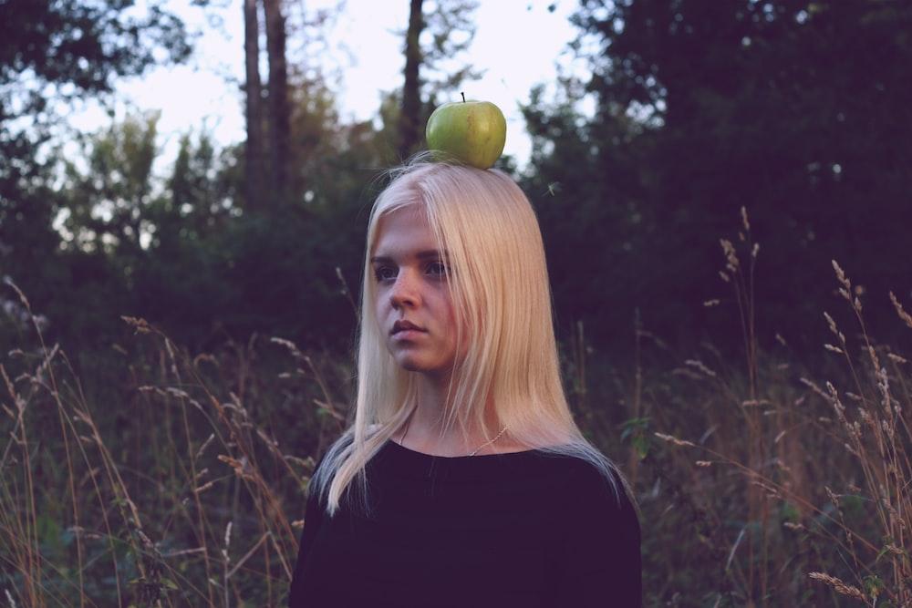 green apple on woman's head