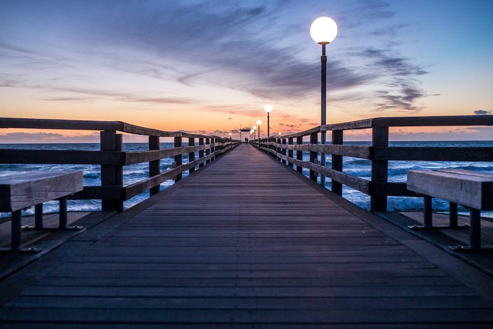brown wooden dock under blue sky