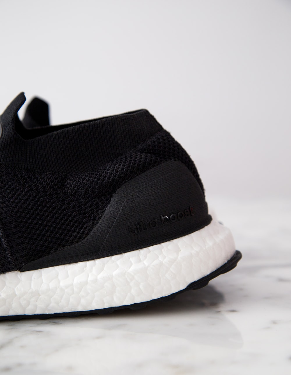 black and white adidas UltraBOOST shoe