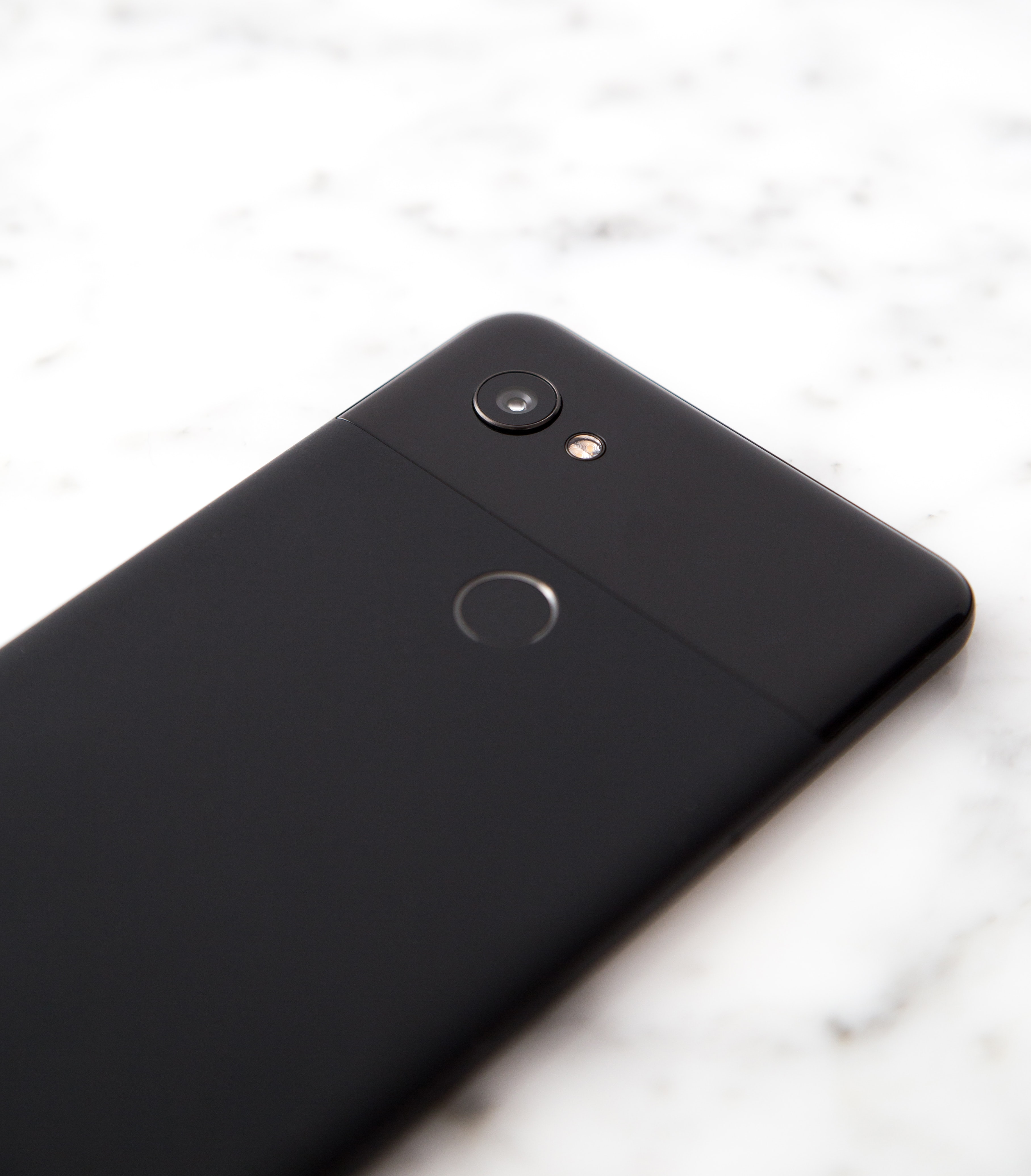 black Android smartphone on gray surface