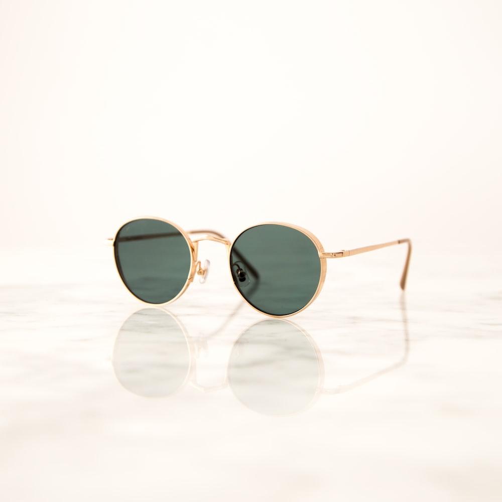 gold framed aviator style sunglasses