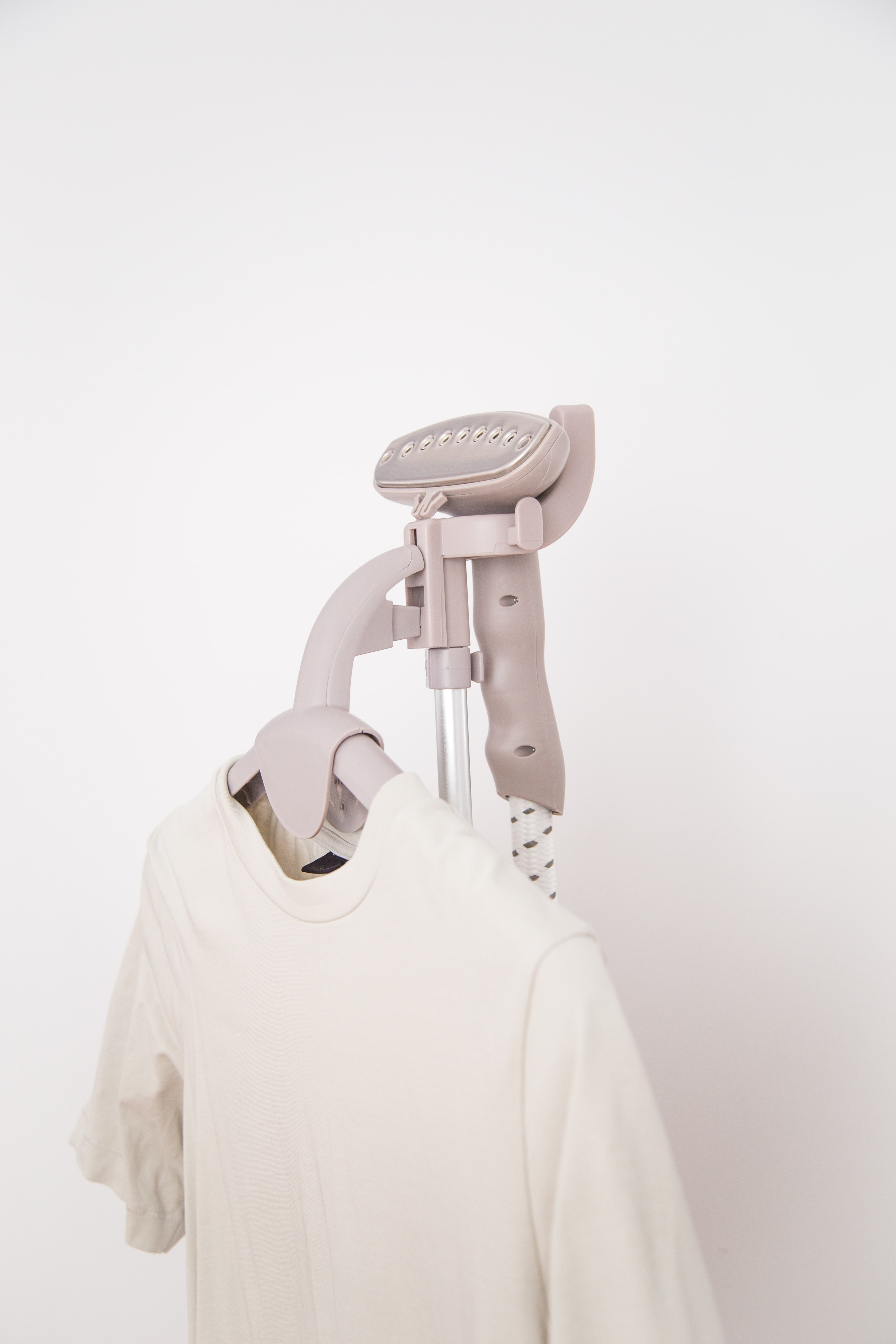 white crew-neck shirt on hanger