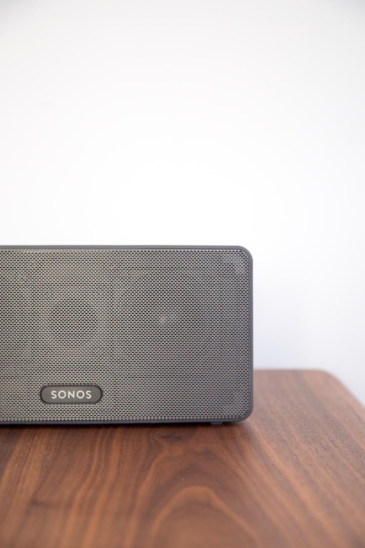 gray Sonos speaker on table