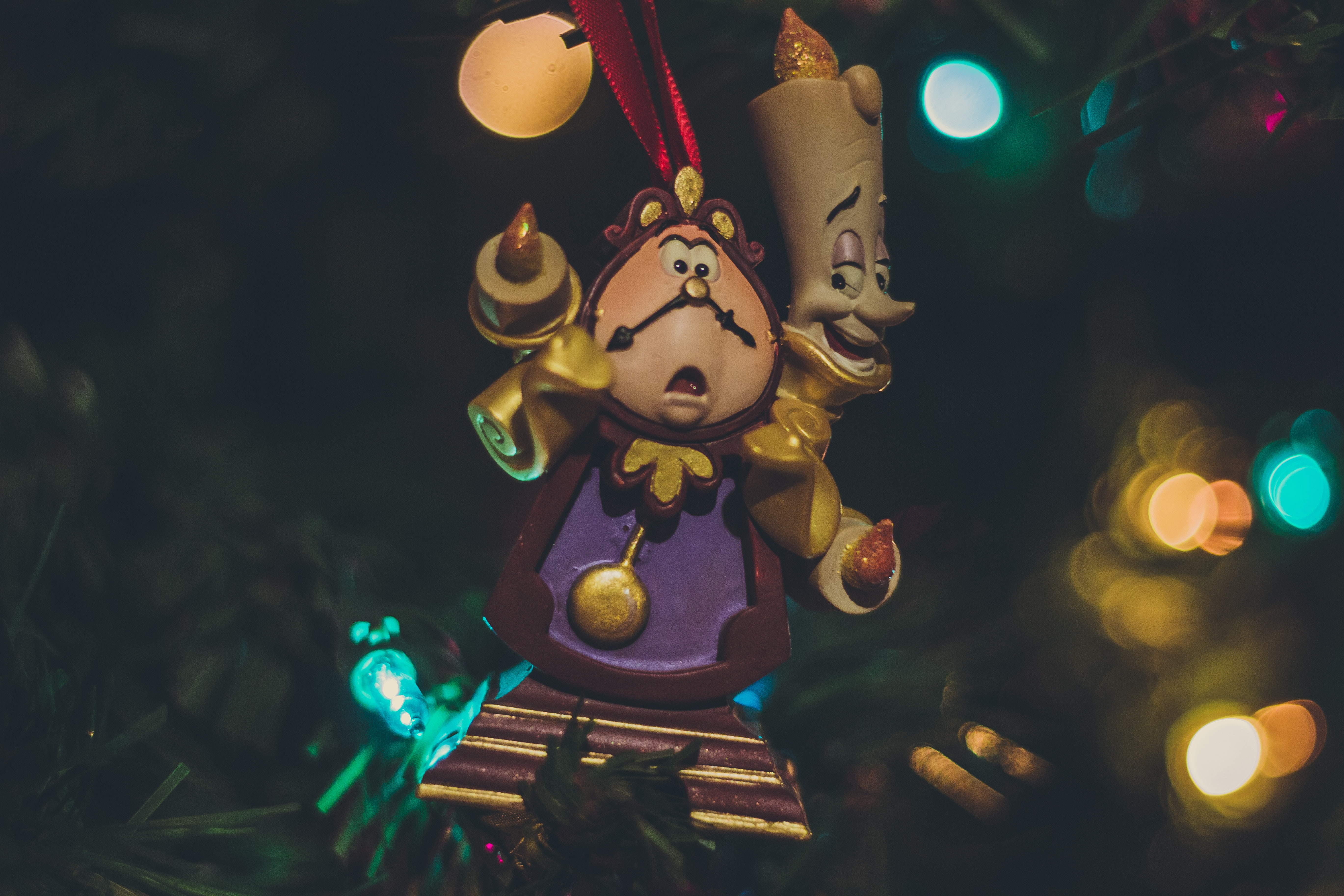 two Disney character surrounded by LED lights