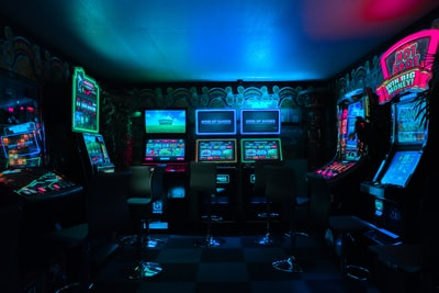 gaming room with arcade machines gaming teams background