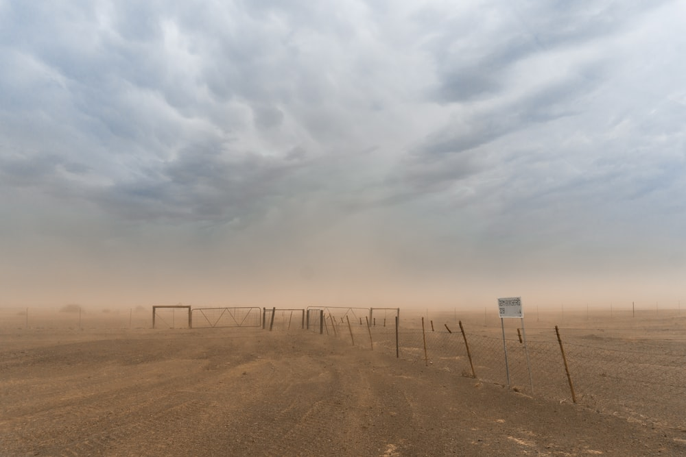 desert with wire fence
