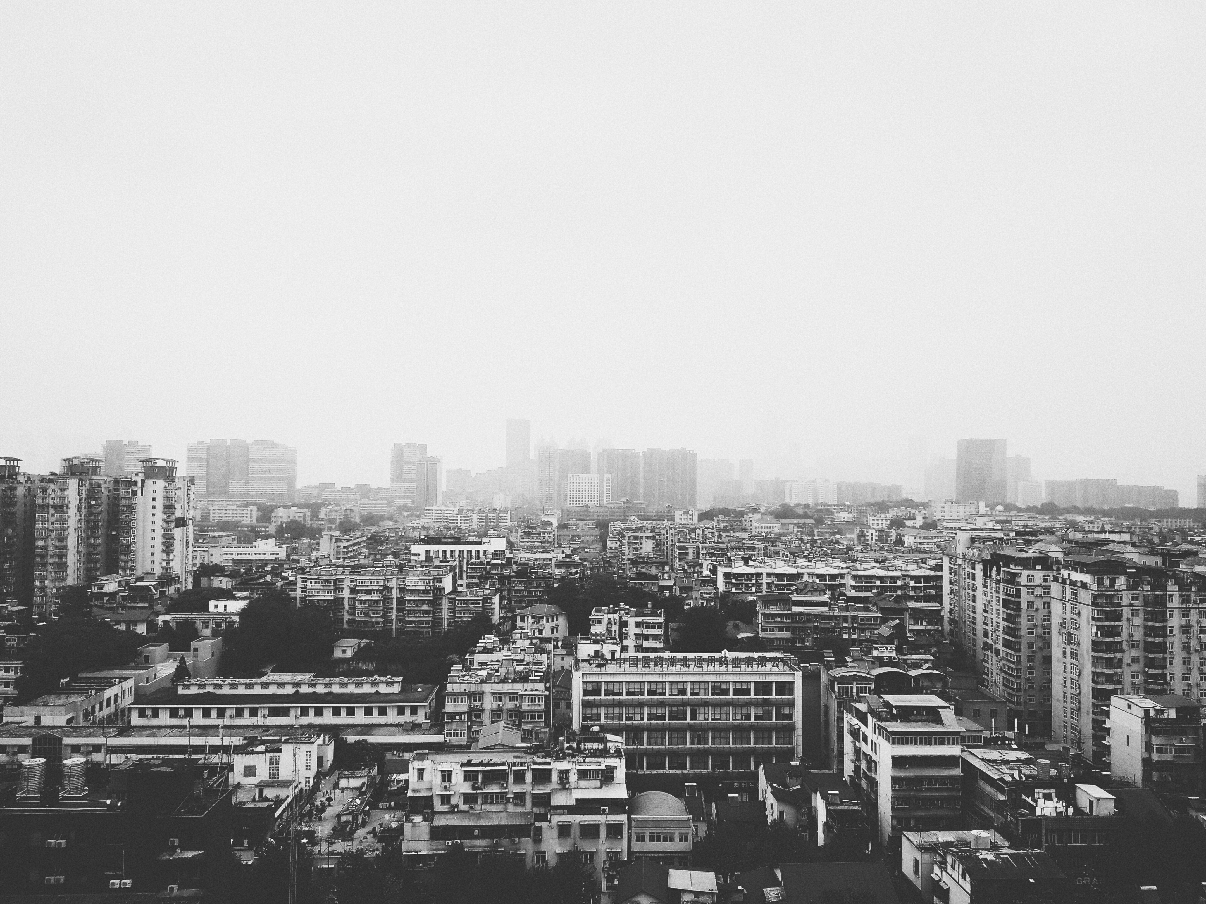 gray scale photo of buildings