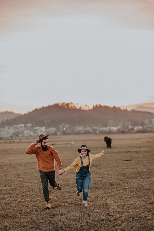 man holdind woman hand