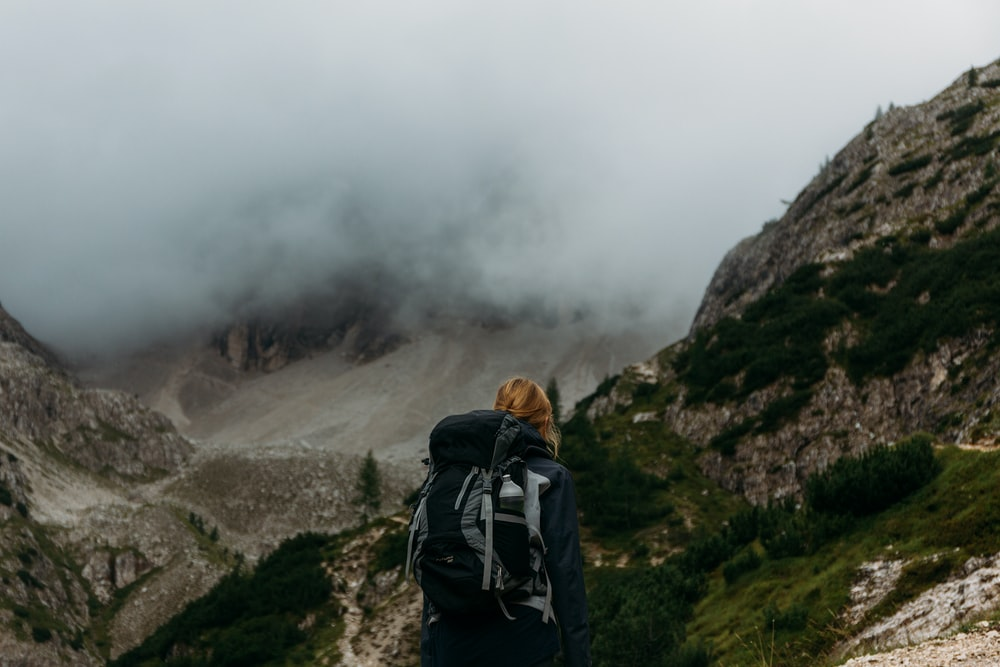 person standing in front of gray mountains