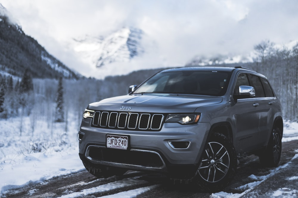 gray Jeep SUV parked on road