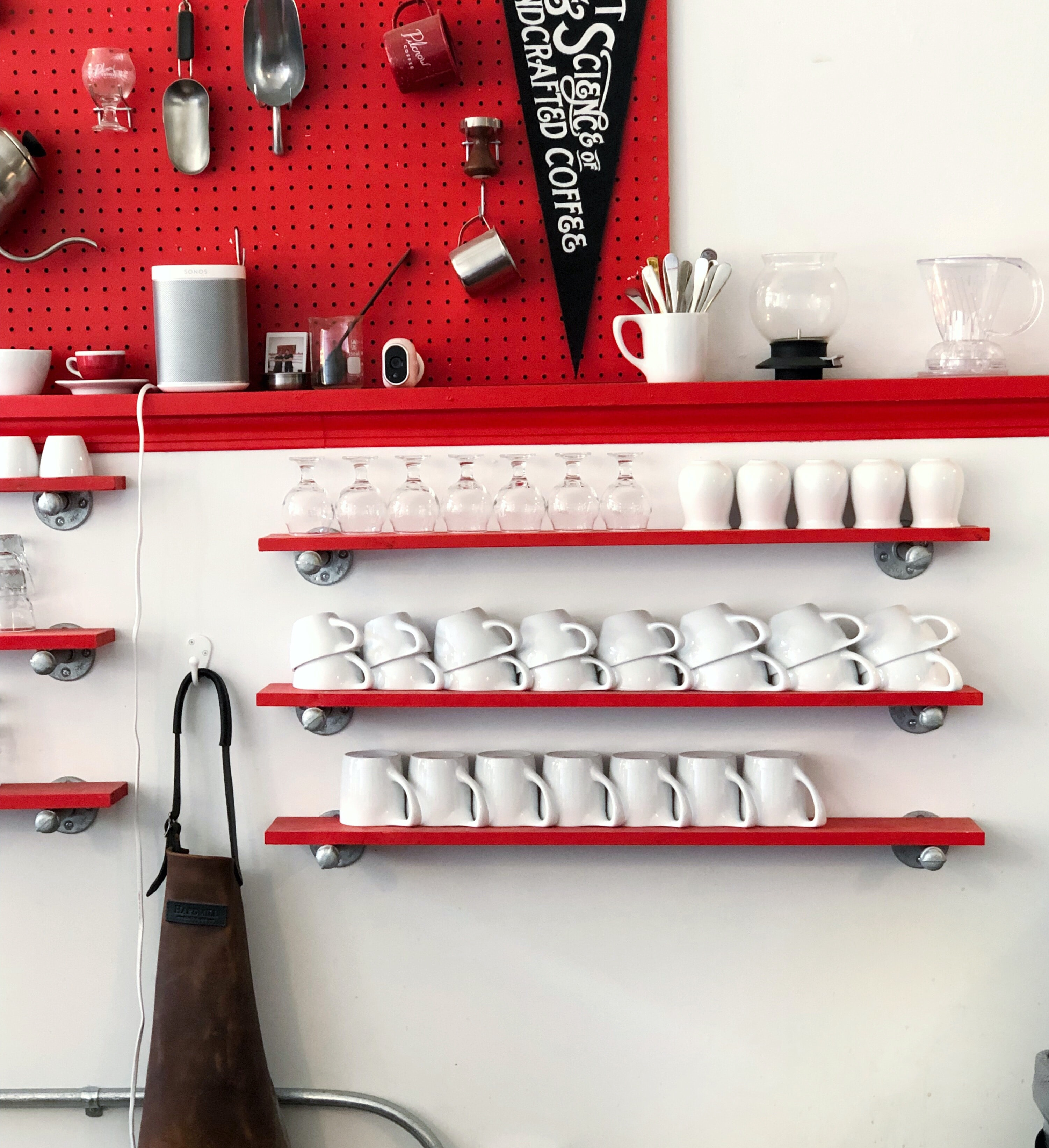 tea cups and wine glasses on shelves