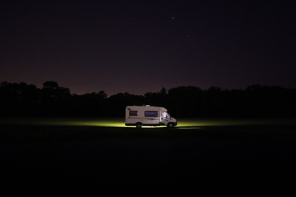 white RV at the road during night