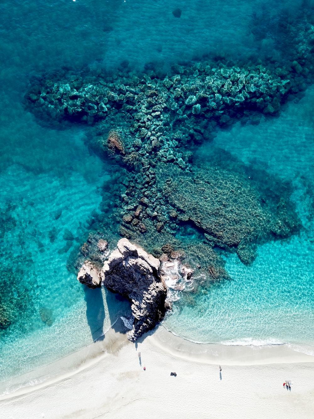 bird's eye view photography of white sand seashore
