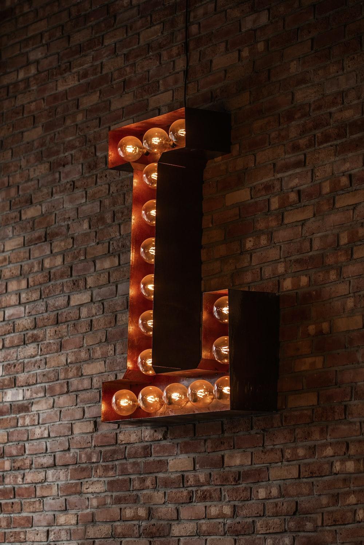 L light signage on wall